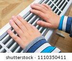 child warming hands in front of ... | Shutterstock . vector #1110350411