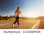 woman runs by straight road to...   Shutterstock . vector #1110369434