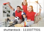 a family of fans watching a... | Shutterstock . vector #1110377531