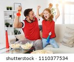 a family of fans watching a... | Shutterstock . vector #1110377534