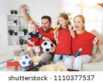 a family of fans watching a... | Shutterstock . vector #1110377537