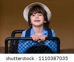 beautiful little brunet hair... | Shutterstock . vector #1110387035