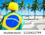 proud brazilian in flag regalia ... | Shutterstock . vector #1110421799