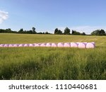picturesque field with straw... | Shutterstock . vector #1110440681