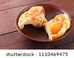 homemade pizza on a clay plate  ... | Shutterstock . vector #1110469475