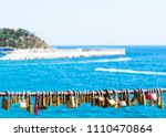 padlocks on rope  blue sea... | Shutterstock . vector #1110470864