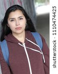 Small photo of Ethnic woman with an intimidating look