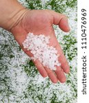 Small photo of Hail on a hand after a storm