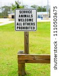 Small photo of Service animals welcome sign