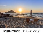 paradise beach at sunrise.... | Shutterstock . vector #1110517919