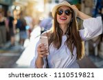 happy and attractive city girl... | Shutterstock . vector #1110519821