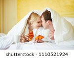 happy young couple in white...   Shutterstock . vector #1110521924