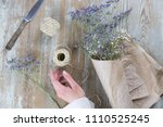 female hand wrapping dry... | Shutterstock . vector #1110525245