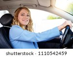 smiling woman in the car on a... | Shutterstock . vector #1110542459