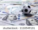 soccer ball on dollar banknotes ...