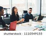 positive diverse team of... | Shutterstock . vector #1110549155
