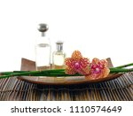 spa set on mat with bottle oil  ... | Shutterstock . vector #1110574649