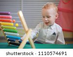 a small child is playing with... | Shutterstock . vector #1110574691