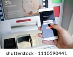 withdraw money from an atm... | Shutterstock . vector #1110590441