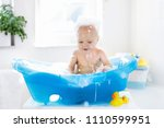 happy laughing baby taking a... | Shutterstock . vector #1110599951