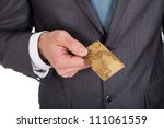Successful businessman holding credit card. Isolated on white - stock photo