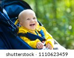 baby in stroller on a walk in... | Shutterstock . vector #1110623459