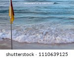 yellow and red flag life savers ... | Shutterstock . vector #1110639125