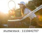 beautiful asian girl playing...   Shutterstock . vector #1110642707
