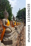 buddhist monk statues in a row  ... | Shutterstock . vector #1110646235