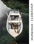 small white wooden rowboat and...   Shutterstock . vector #1110651419