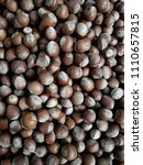 top view of shelled hazelnuts.... | Shutterstock . vector #1110657815