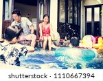 family playing in a pool | Shutterstock . vector #1110667394