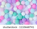 a colorful  pom pom background | Shutterstock . vector #1110668741