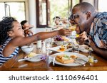 guests having breakfast at... | Shutterstock . vector #1110696401