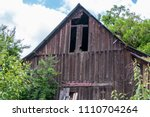 an old barn with a peaked rood... | Shutterstock . vector #1110704264