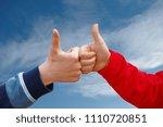 two children's hands thumb up... | Shutterstock . vector #1110720851