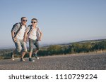 father and son running on the... | Shutterstock . vector #1110729224