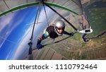 brave hang glider pilot soar... | Shutterstock . vector #1110792464