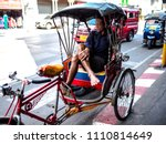 Small photo of Chiangmai, Thailand FEBRUARY 10, 2018: Uncle Tricycle Waiting for customers Hopefully.Thailand's economic condition In the provinces are affected.