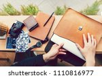 man pulling out a laptop out of ... | Shutterstock . vector #1110816977