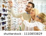happy family choosing glasses... | Shutterstock . vector #1110853829