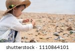 asian baby playing by the beach | Shutterstock . vector #1110864101
