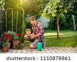 gardener taking care of plants... | Shutterstock . vector #1110878861