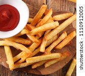 french fried and ketchup | Shutterstock . vector #1110912005
