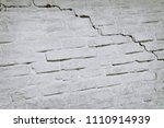 brick house with a crack for... | Shutterstock . vector #1110914939
