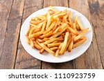 french fried on plate | Shutterstock . vector #1110923759
