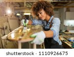 happy young woman working on... | Shutterstock . vector #1110926675
