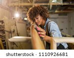 happy young woman working on... | Shutterstock . vector #1110926681