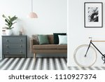 chest of drawers next to a sofa ... | Shutterstock . vector #1110927374