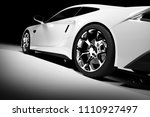 Stock photo modern white sports car in a spotlight on a black background front view d render luxury cars 1110927497